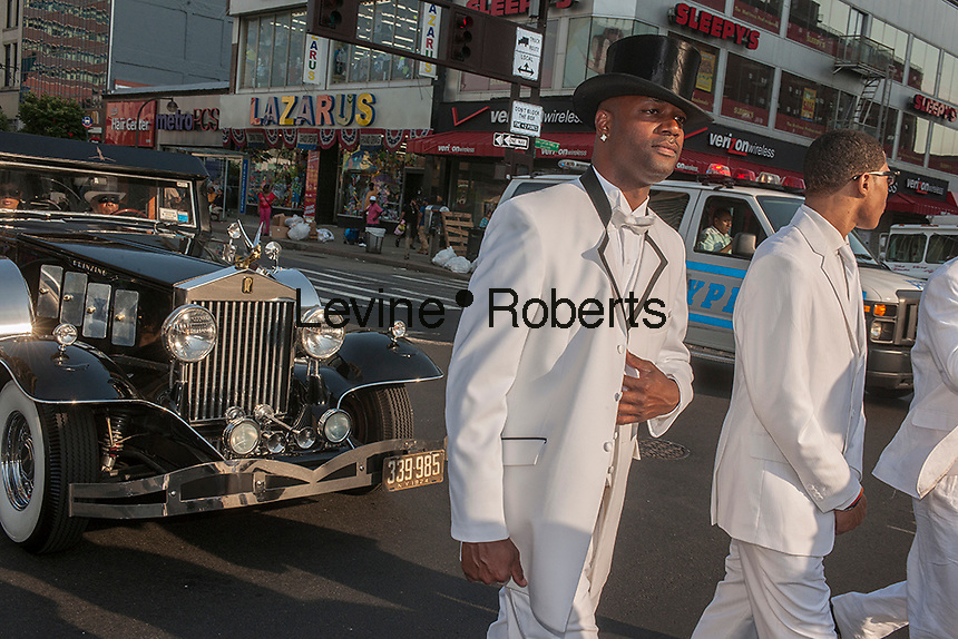 """Isaiah Owens, the owner of Owens Funeral Home, in Harlem in New York driving his 1924 Rolls-Royce hearse, in a procession, on Friday, June 21, 2013, to the Apollo Theater for a showing of Christine Turner's documentary film """"Homegoings"""".  The film features Owens and his funeral home as it studies African-American traditions of death. Owens, who moved to New York in the 1960's, opened the funeral home and with just word of mouth and little advertising has become the paramount funeral home in Harlem, due to his care and understanding.  (© Richard B. Levine)"""