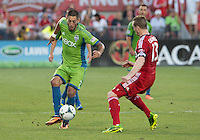 August 10, 2013: Seattle Sounders FC forward Clint Dempsey #2 and Toronto FC defender Steven Caldwell #13 in action during an MLS regular season game between the Seattle Sounders and Toronto FC at BMO Field in Toronto, Ontario Canada.