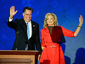 GOP nominee Mitt Romney joins his wife, Ann, at the podium after she made remarks at the 2012 Republican National Convention in Tampa Bay, Florida on Tuesday, August 28, 2012.  .Credit: Ron Sachs / CNP.(RESTRICTION: NO New York or New Jersey Newspapers or newspapers within a 75 mile radius of New York City)