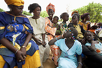 Senegal. Province of Thies. Village Nekhe Niane. A group of women with children listen to a lecture on malaria's prevention. Nekhe Niane is far from health infrastructure. The PNLP ( Programme National de Lutte contre le Paludisme) has decided to run a malaria program and therefore had implemented the home-based care strategy in the village (PECADOM Prise en charge à domicile). The Global fund supports the PNLP with a financial grant. 4.12.09 © 2009 Didier Ruef