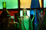 Bottles and stain glass window study.