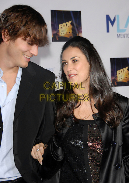 ASHTON KUTCHER & DEMI MOORE.Attends The Mentor L.A. Promise Gala honoring Tom Cruise at The Twentieth Century Fox Studios stage 5 in Century City, California, USA..half length black profile married husband wife .CAP/DVS.©Debbie VanStory/Capital Pictures