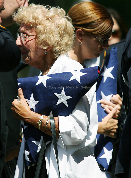 Funeral for North Brunswick Police Lt. Chris Zerby at the Franklin Memorial Park , North Brunswick. Here Zerby's mother (left) Sara Zerby and wife Christine (right) both hold American Flags given to them during the service for the fallen Lt. Chris Zerby.<br /> METRO<br /> 3066<br /> ON SAT AUG.2, 2008<br /> MARK R. SULLIVAN/CHIEF PHOTOGRAPHER