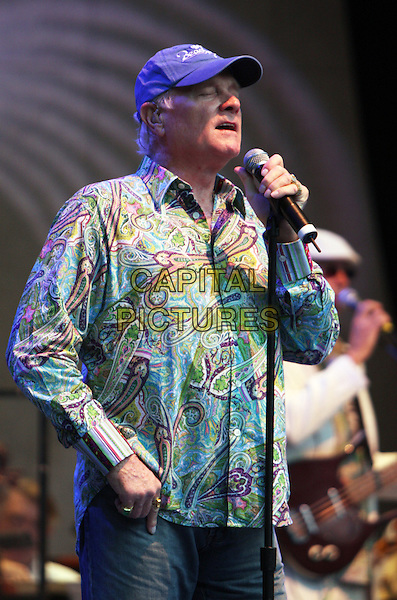 THE BEACH BOYS - Mike Love  .Live in concert at Chastain Park in Georgia, GA, USA, August 13, 2008..concert gig group band music live on stage performing cap hat microphone  print patterned green shirt half length .CAP/ADM/DH.©Dan Harr/AdMedia/Capital Pictures