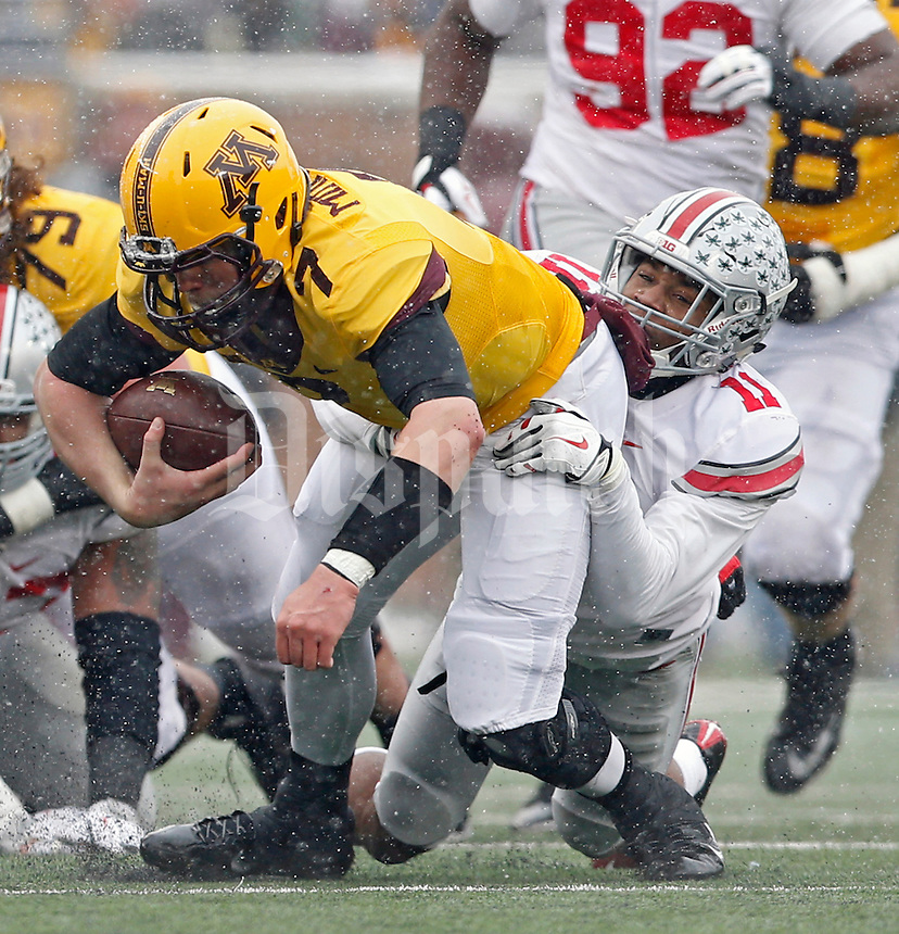 Ohio State Buckeyes defensive back Vonn Bell (11) takes down Minnesota Golden Gophers quarterback Mitch Leidner (7) during the 2nd quarter at TCF Bank Stadium in Minneapolis, Minn. on November 15, 2014.  (Dispatch photo by Kyle Robertson)