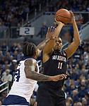San Diego State forward Matt Mitchell (11) shoots over Nevada forward Jordan Caroline (24) in the first half of an NCAA college basketball game in Reno, Nev., Saturday, Mar. 9, 2019. (AP Photo/Tom R. Smedes)
