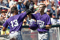 TCU Horned Frogs second baseman Cam Warner (4) is greeted by teammate Michael Landestoy (13) after hitting a home run against the Texas Tech Red Raiders in Game 3 of the NCAA College World Series on June 19, 2016 at TD Ameritrade Park in Omaha, Nebraska. TCU defeated Texas Tech 5-3. (Andrew Woolley/Four Seam Images)