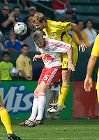 Chad Marshall heads the ball over John Wolyneic during MLS Cup 2008. Columbus Crew defeated the New York Red Bulls, 3-1, Sunday, November 23, 2008. Photo by John Todd/isiphotos.com