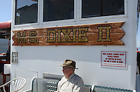 MS Dixie II, name plate, signage, paddle steamer, moored, Zephyr Cove, Nevada, USA, is the largest vessel on South Lake Tahoe. The lake itself is split vertically between Nevada in the East and California in the West. It traverses the lake from Zephyr Cove to Emerald Bay in California. 201304261909<br /> <br /> Copyright Image from Victor Patterson, 54 Dorchester Park, Belfast, UK, BT9 6RJ<br /> <br /> Tel: +44 28 9066 1296<br /> Mob: +44 7802 353836<br /> Voicemail +44 20 8816 7153<br /> Skype: victorpattersonbelfast<br /> Email: victorpatterson@me.com<br /> Email: victorpatterson@ireland.com (back-up)<br /> <br /> IMPORTANT: If you wish to use this image or any other of my images please go to www.victorpatterson.com and click on the Terms & Conditions. Then contact me by email or phone with the reference number(s) of the image(s) concerned.