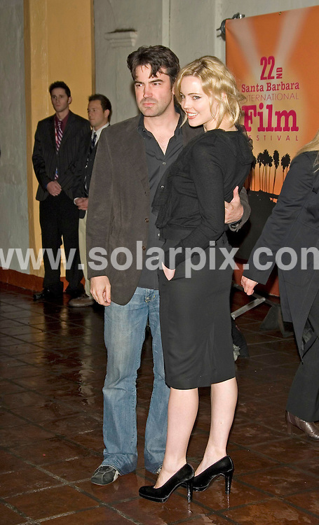ALL ROUND PICTURES BY SOLARPIX.COM .This picture - Melissa George and Ron Livingston  .Santa Barbara International Film Festival Presents the Modern Master Award to Will Smith - Arlington Theatre - Santa Barbara, CA, USA.JOB REF:  3286  PHZ   DATE: 27.01.07.**MUST CREDIT SOLARPIX.COM OR DOUBLE FEE WILL BE CHARGED**