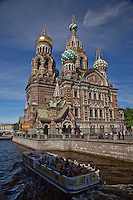 Tour boat cruises near Church of Savior on Spilled Blood-St. Petersburg,Russia
