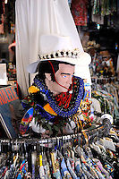 "An Elvis bust amongst Hawaiian shirts (aka ""aloha shirts"") for sale at Bailey's Antiques and Aloha Shirts store in Honolulu, Hawaii"