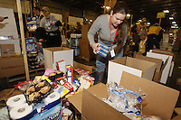"Friday, February 15, 2013.   Volunteer Molly Farr packs an assortment of ""people food"" to be sent out to the Grayling checkpoint along the Iditarod trail at Airland Transport in Anchorage."
