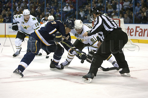 24th October 2009: Blues Keith Tkachuk (7, left) and Stars player Brad Richards (91, right) vie for the puck after linesman Bryan Pancich (94, far right) drops it in a first period faceoff.    The St. Louis Blues hosted the Dallas Stars at the Scottrade Center in downtown St. Louis, MO on Saturday October 24, 2009.   The Stars defeated the Blues, 4-1. Photo by Tim Vizer/Actionplus. UK Licenses only.