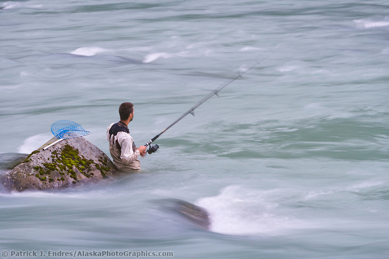 Fisherman wades in the Chilkoot River, Haines, Alaska