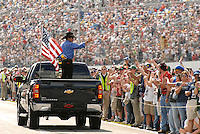 NASCAR racing legend Richard Petty waves to adoring fans from the back of a pick-up truck during pre-race ceremonies for the Daytona 500 at Daytona International Speedway in Daytona Beach, Fl. (The Florida Times-Union, Rick Wilson)