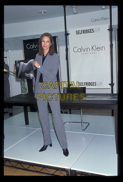 CHRISTIE TURLINGTON.At Selfridges.Ref:7026.trouser suit, full length, full-length, christy.*RAW SCAN- photo will be adjusted for publication*.www.capitalpictures.com.sales@capitalpictures.com.©Capital Pictures