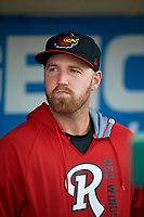 Rochester Red Wings pitcher Dietrich Enns (23) in the dugout during a game against the Pawtucket Red Sox on May 19, 2018 at Frontier Field in Rochester, New York.  Rochester defeated Pawtucket 2-1.  (Mike Janes/Four Seam Images)