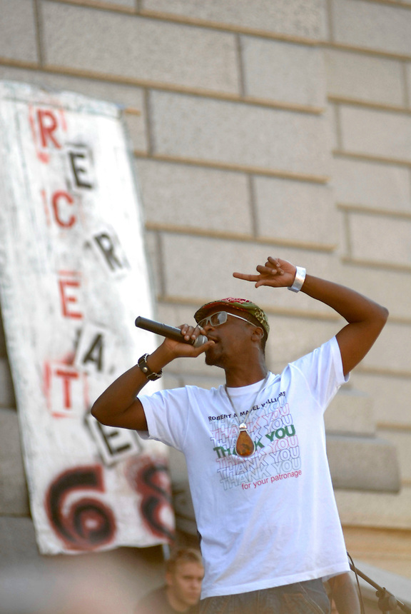 24 Aug 08: Rapper M-1 of the hip-hop duo Dead Prez performs on the steps of the Colorado state capitol building.  On the day before the Democratic National Convention is scheduled to begin about 1,500 people participated in the ReCreate 68 rally, which included a march from the Colorado state capitol building to the Pepsi Center.