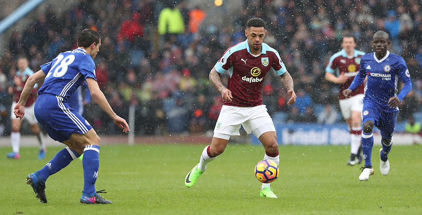 Burnley's Andre Gray attacks Chelsea's Cesar Azpilicueta with Chelsea's Ngolo Kante in pursuit<br /> <br /> Photographer Rachel Holborn/CameraSport<br /> <br /> The Premier League - Burnley v Chelsea - Sunday February 12th 2017 - Turf Moor - Burnley<br /> <br /> World Copyright &copy; 2017 CameraSport. All rights reserved. 43 Linden Ave. Countesthorpe. Leicester. England. LE8 5PG - Tel: +44 (0) 116 277 4147 - admin@camerasport.com - www.camerasport.com