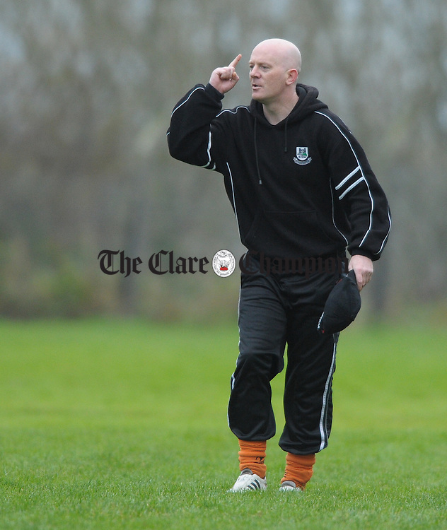 Clarecastle mentor Derek Dormer on the sideline during the Junior A football final at Corofin. Photograph by John Kelly.