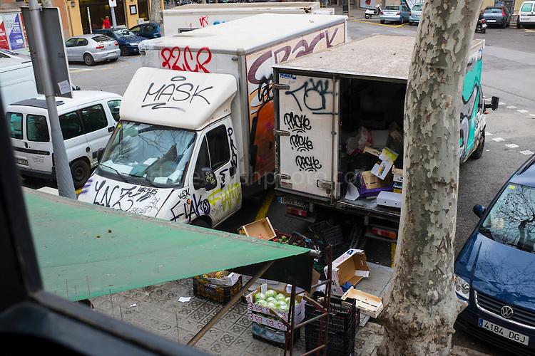 Graffiti-covered Trucks in Barcelona delivering fruit and vegetables