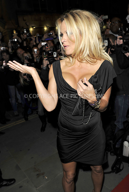 WWW.ACEPIXS.COM . . . . .  ..... . . . . US SALES ONLY . . . . .....October 25 2010, London....Pamela Anderson at the premiere of 'The Commuter' on October 25 2010 in London....Please byline: FAMOUS-ACE PICTURES... . . . .  ....Ace Pictures, Inc:  ..Tel: (212) 243-8787..e-mail: info@acepixs.com..web: http://www.acepixs.com