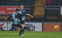 Joe Jacobson of Wycombe Wanderers takes a free kick during the Sky Bet League 2 match between Wycombe Wanderers and Morecambe at Adams Park, High Wycombe, England on 2 January 2016. Photo by Andy Rowland / PRiME Media Images