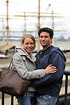 Bridal couple with engagement photo at the South Street Seaport, one month prior to their wedding.