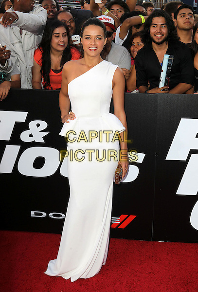 "Michelle Rodriguez.""Fast & Furious 6"" Los Angeles Premiere held at the Universal Gibson Amphitheatre, Universal City, California, USA..May 21st, 2013.full length white one shoulder dress hand on hip peplum gold clutch bag .CAP/ADM/KB.©Kevan Brooks/AdMedia/Capital Pictures"