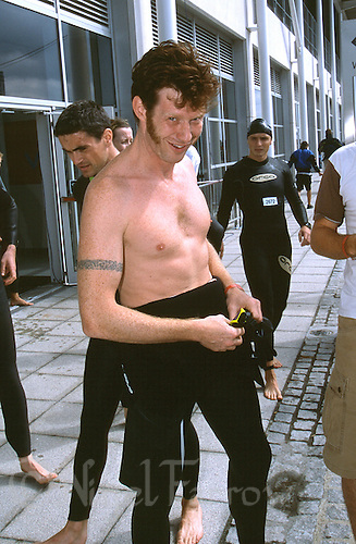 11 AUG 2002 - LONDON, UK - Actor Jason Flemyng prepares for the race start - London Triathlon (PHOTO (C) NIGEL FARROW)