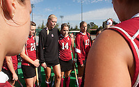STANFORD, CA - November3, 2011: Team huddles before the Stanford vs. Appalachian State opener of  the  NorPac Championship at the Varsity Turf on the Stanford campus Thursday afternoon.<br /> <br /> <br /> Stanford defeated Appalachian State 7-0.