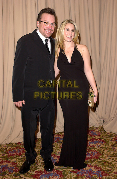 TOM ARNOLD & WIFE.The Saks Fifth Avenue's Unforgettable Evening honouring Lance Armstrong by Entertainment Industry Foundation's Women's Cancer Fund held at The Regent Beverly Wiltshire in Beverly Hills, California  .March 1st, 2005.full length black suit couple married husband .www.capitalpictures.com.sales@capitalpictures.com.Supplied By Capital PIctures