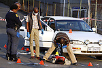 DURBAN - 19 August 2013 - The South African police's forensics investigators examine a crime scene in the Westmead Industrial complex of Pinetown where a hijacker was shot and killed by his intended victim. The victims - a husband and wife - were wounded in the shoot outr and rushed to hospital while the hijacker's three accomplices fled. Picture: Allied Picture Press/APP