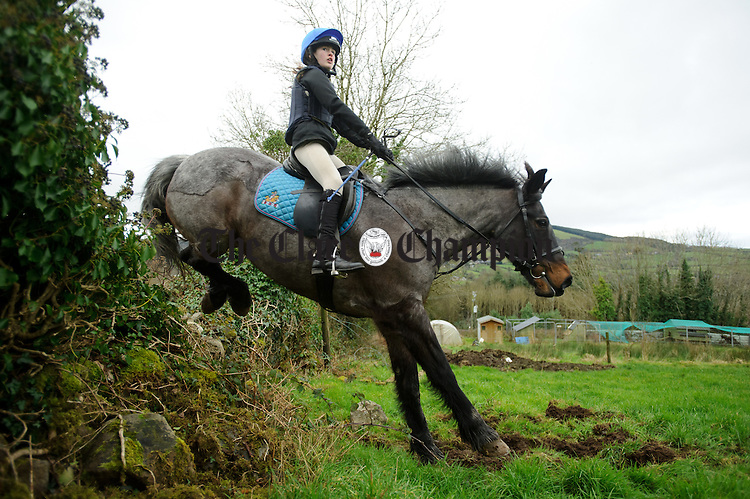 Local girl Eva Vaughan jumping a wall at the East Clare Harriers hunt in Broadford. Photograph by John Kelly.