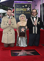 HOLLYWOOD, CA - JANUARY 8: Joel McHale, Gillian Anderson, Bryan Fuller, at Gillian Anderson Honored With Star On The Hollywood Walk Of Fame at On The Hollywood Walk Of Fame in Hollywood, California on January 8, 2018. <br /> CAP/MPI/FS<br /> &copy;FS/MPI/Capital Pictures