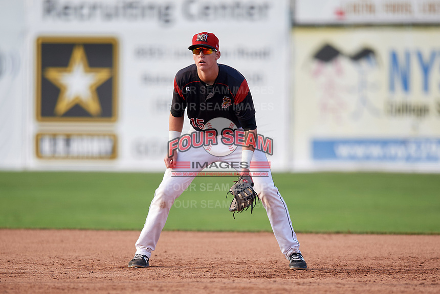Batavia Muckdogs first baseman Sean Reynolds (15) delivers a pitch during the first game of a doubleheader against the Mahoning Valley Scrappers on August 28, 2017 at Dwyer Stadium in Batavia, New York.  Mahoning Valley defeated Batavia 6-3.  (Mike Janes/Four Seam Images)