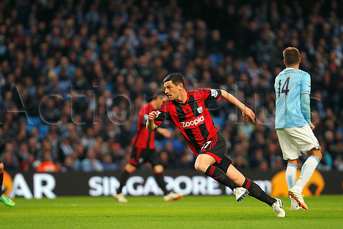 21.04.2014.  Manchester, England. Graham Dorrans of WBA turns to clebrate his goal during the Barclays Premier League match between Manchester City and West Bromwich Albion from The Etihad Stadium.