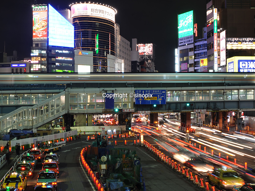 Cars, trains, taxi and buses in the busy Shibuya station district Tokyo, Japan.