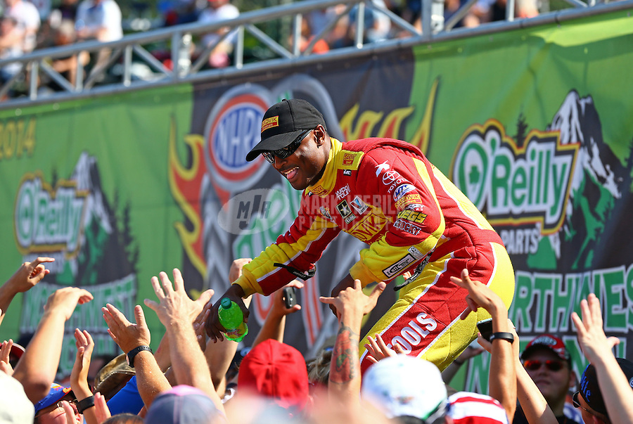 Aug. 3, 2014; Kent, WA, USA; NHRA top fuel dragster driver Antron Brown greet fans during driver introduction prior to the Northwest Nationals at Pacific Raceways. Mandatory Credit: Mark J. Rebilas-USA TODAY Sports