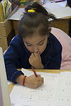 Oakland CA 2nd grade Latina student taking standardized Oakland School District math test