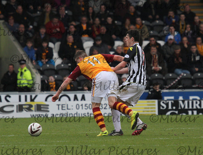John McGinn tackles Iain Vigurs in the St Mirren v Motherwell Scottish Professional Football League Premiership match played at St Mirren Park, Paisley on 5.4.14.