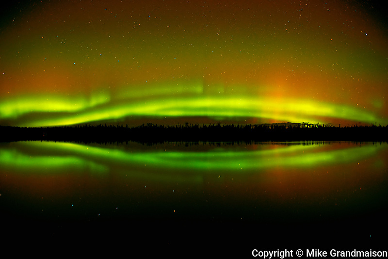 Northern lights  (Aurora borealis) reflected in Klotz Lake<br />