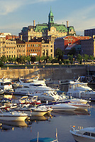 AJ0811, Canada, Quebec, Montreal, Marina at Vieux Port and skyline of Vieux Montreal on the waters of St. Lawrence River (Fleuve Saint-Laurent).
