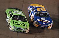 Apr 20, 2007; Avondale, AZ, USA; Nascar Busch Series driver Clint Bowyer (2) and Matt Kenseth (17) race side by side for the lead during the Bashas Supermarkets 200 at Phoenix International Raceway. Mandatory Credit: Mark J. Rebilas