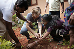 INDIA, KERALA JUNE 2014: <br />Sabriye Tenberken and Soni Resal planting a tree for the eviromental day donated by the Kerala government, june 2014, @Giulio Di Sturco