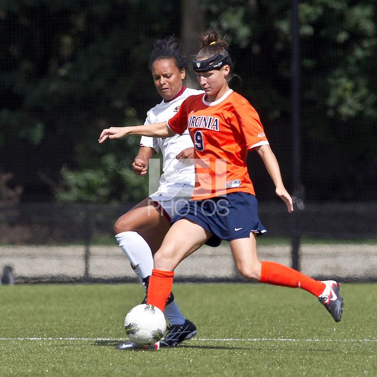 University of Virginia forward Lauren Alwine (9) passes the ball as Boston College midfielder/defender Casey Morrison (3) defends. Boston College defeated University of Virginia, 2-0, at the Newton Soccer Field, on September 18, 2011.
