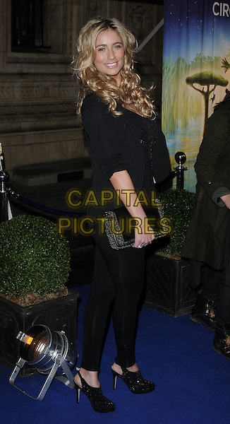 "CHANTELLE HOUGHTON .At the Cirque du Soleil ""Totem"" press Tour, Royal Albert Hall, Kensignton Gore, London, 5th January 2011..Full length black jacket top shoes leggings clutch bag platform slingbacks shooboots smiling .CAP/CAN.©Can Nguyen/Capital Pictures."