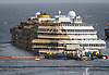 THE COSTA CONCORDIA<br /> was finally rolled over after a 19 hour operation that ended early this morning.<br /> It was the biggest salvage operation of a passenger liner.<br /> The 114,000-tonne ship ran aground 20 months on 13 January 2012 ago off the island of Giglio with the loss of 32 passengers, with two bodies still to be recovered.<br /> Mandatory Credit Photo: &copy;Bramo-Sestini/NEWSPIX INTERNATIONAL<br /> <br /> **ALL FEES PAYABLE TO: &quot;NEWSPIX INTERNATIONAL&quot;**<br /> <br /> IMMEDIATE CONFIRMATION OF USAGE REQUIRED:<br /> Newspix International, 31 Chinnery Hill, Bishop's Stortford, ENGLAND CM23 3PS<br /> Tel:+441279 324672  ; Fax: +441279656877<br /> Mobile:  07775681153<br /> e-mail: info@newspixinternational.co.uk