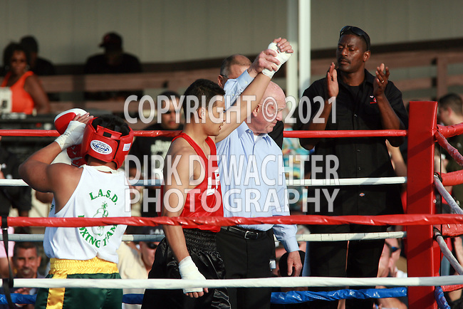 """Whittier, CA 05/10/08 - Jason Birondo of the Los Angeles City Fire Department (in red shirt and black trunks) boxes against Los Angeles County Sheriff's Department's Rommel """"Muscles"""" Asprer during the LASD boxing event held at the Los Angeles County Sheriff's Academy in Whittier."""